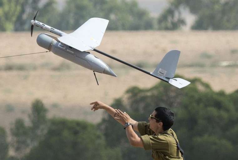 An Israel soldier launches an Israeli army's Skylark I unmanned drone aircraft, which is used for monitoring purposes, at an army deployment area near Israel's border with the besieged Palestinian territory on July 23, 2014, as the conflict entered its third week with neither side showing any sign of willingness to pull back. Israel's military pursued a relentless campaign of shelling and air strikes while the Palestinian militants hit back with rocket fire and fierce attacks on troops operating on the ground. Around 650 Palestinians and 29 Israeli soldiers have been killed in the Gaza fighting which began on July 8. (Jack Guez/AFP/Getty Images)